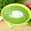 Tasty spinach soup, on wooden table — Stock Photo #34429147