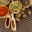 Many different spices and fragrant herbs on wooden table close-up — Stock Photo #34429281