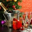 Composition with Christmas decorations and two champagne glasses, on bright background — Stock Photo #34429545