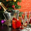 Composition with Christmas decorations and two champagne glasses, on bright background — Stock Photo