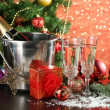 Composition with Christmas decorations and two champagne glasses, on bright background — Stock Photo #34429549