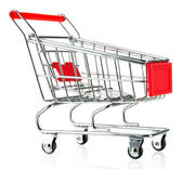 Empty shopping trolley, isolated on white — Stok fotoğraf