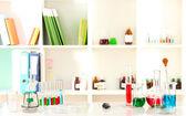 Different laboratory glassware with color liquid on laboratory background — Stock Photo