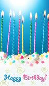 蓝色背景上的美丽生日蜡烛 — 图库照片