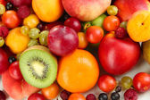 Assortment of juicy fruits background — Stock Photo
