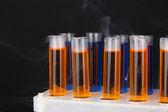 Laboratory test tubes on black background — Stock Photo
