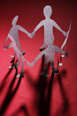 Paper people in social network concept on dark background — Stock Photo