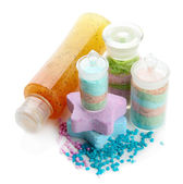 Aromatic salts in glass bottles and body scrub, isolated on white — Stock Photo