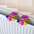 Knitted gloves drying on heating radiator — Stock Photo #34431639