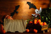 Halloween composition on brown wooden background — Stok fotoğraf