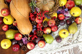 Autumn composition of fruits, pumpkins and flowers on table close-up — Stock Photo