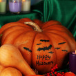 Stock Photo: Composition for Halloween with pumpkins and many candles close-up