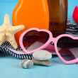 Beach items on beach background — Stock Photo