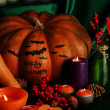 Composition for Halloween with pumpkins and many candles close-up — Stock Photo