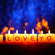 Candles with printed sign I LOVE YOU,on  blur lights background — Lizenzfreies Foto
