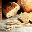 Much bread on wooden board — Stock Photo #34498161