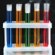 Laboratory test tubes on black background — Zdjęcie stockowe