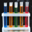 Laboratory test tubes on black background — Photo