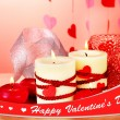 Candles for Valentine's Day on wooden table on red background — Stok fotoğraf