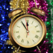 Golden clock on bright background — Stock Photo #34499471