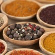 Assortment of spices in wooden spoons, close-up — Stock Photo