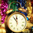 Composition of clock and christmas decorations on bright background — Stock Photo