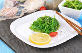 Sea kale on plate on wooden table close-up — Stock Photo