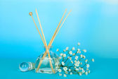Aromatic sticks for home with floral odor on blue background — Foto Stock
