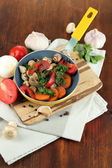 Sliced fresh vegetables in pan on wooden table close-up — Stock Photo