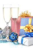 Glasses of champagne with gift boxes isolated on white — Stock Photo