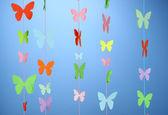 Handmade paper garland on blue background — Stock Photo