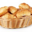 Tasty croissants in wicker basket isolated on white — Stock Photo #34500593