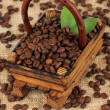 Coffee beans in wooden basket on table close-up — Stock Photo