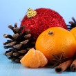 Christmas composition with tangerines on wooden table on blue background — Photo