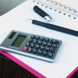 Notebook with pen and calculator close up — Stock Photo