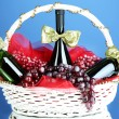 Gift basket with wine on blue background — Stock Photo #34502945