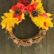 Beautiful Thanksgiving wreath, on wooden background — Stock Photo #34504137