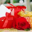Gift box with blank label and rose on table on bright background — Stock Photo