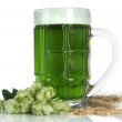 Stock Photo: Glass of green beer and hops, isolated on white