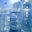 Bottles with water in refrigerator — Stockfoto