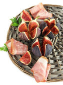 Tasty figs with ham, isolated on white — Stock Photo