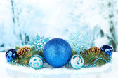 Composition of the Christmas decorations on light winter background — Stok fotoğraf