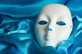 Mask on blue fabric background — Stock Photo