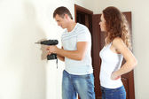 Young couple doing renovation in new house — Stockfoto