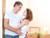 Young couple in new house on room background — Stock Photo