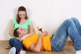 Young couple resting from renovation in new flat — Foto de Stock