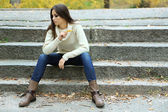 Young lonely woman outdoors — Stock Photo
