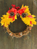 Beautiful Thanksgiving wreath, on wooden background — Stock Photo