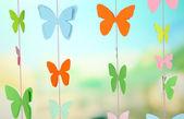 Handmade paper garland on bright background — Stock Photo
