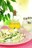 Delicious salad with eggs, cabbage and cucumbers on table — Stock Photo